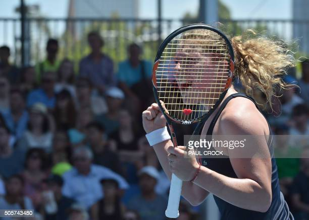 Germany's AnnaLena Friedsam celebrates after victory in her women's singles match against China's Wang Qiang on day three of the 2016 Australian Open...