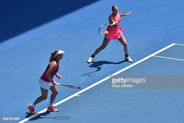 Germany's AnnaLena Groenefeld and Coco Vandeweghe of the US compete during their women's doubles match against India's Sania Mirza and Switzerland's...