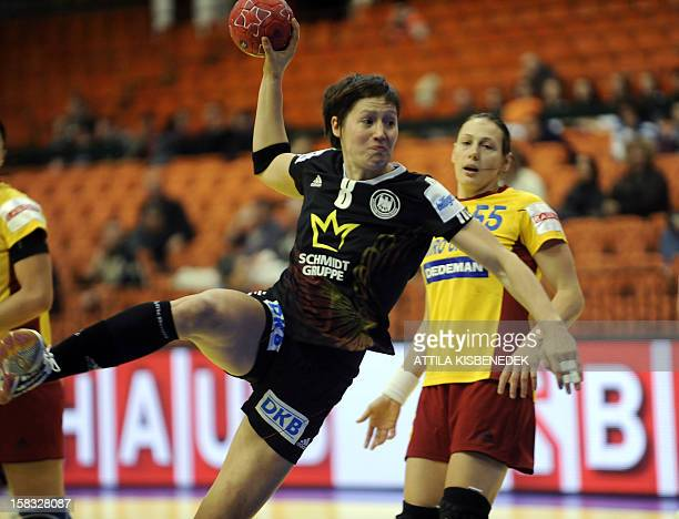 Germany's Anne Müller scores a goal against Romania's Melinda Geiger during the 2012 EHF European Women's Handball Championship Group II match of...