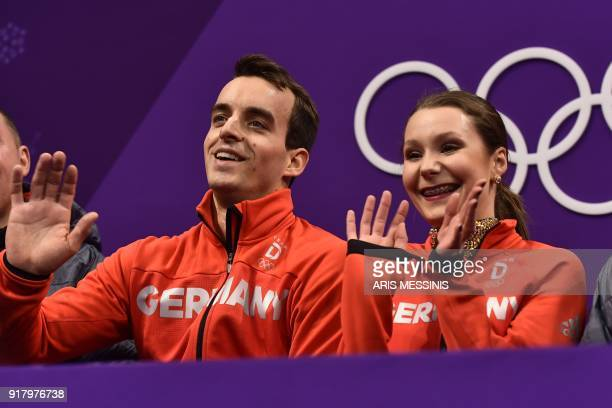 Germany's Annika Hocke and Germany's Ruben Blommaert react after competing in the pair skating short program of the figure skating event during the...