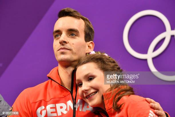 Germany's Annika Hocke and Germany's Ruben Blommaert react after the pair skating free skating of the figure skating event during the Pyeongchang...