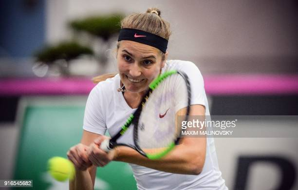 Germany's Antonia Lottner hits a return to Belarus' Aliaksandra Sasnovich during the Fed Cup tennis world group first round match between Belarus and...