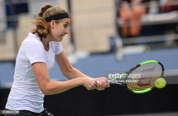 Germany's Antonia Lottner hits a return to Belarus' Aryna Sabalenka during the Fed Cup tennis world group first round match between Belarus and...