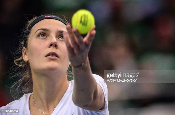 Germany's Antonia Lottner serves to Belarus' Aliaksandra Sasnovich during the Federation Cup tennis world group first round match between Belarus and...