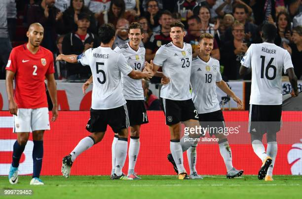 Germany's Antonio Ruediger Joshua Kimmich Mario Gomez Leon Goretzka and Mats Hummels cheer over the 60 score during the soccer World Cup...