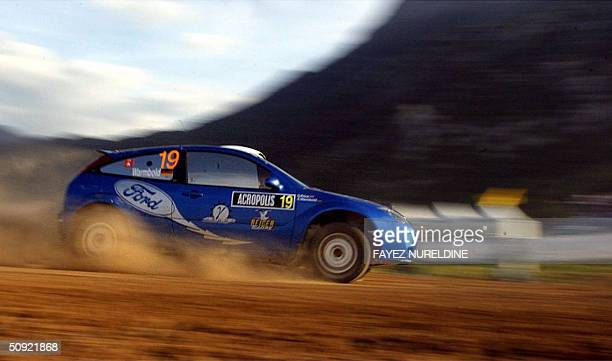 Germany's Antony Warmbold and his codriver Gemma Price compete with their Ford Focus WRC during the Acropolis Rally of Greece in Lilea special stage...