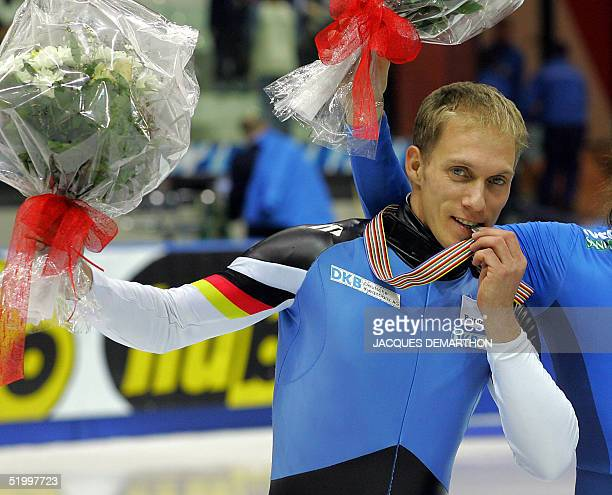 Germany's Arian Nachbar bites his silver medal after the men's 500m final 15 January 2005 in Torino of the 2005 European Short Track Speed Skating...