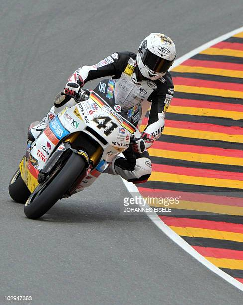 Germany's Arne Tode of the Racing Team Germany steers his bike during the qualifying practice of the Moto2 race at the Sachsenring Circuit on July 17...