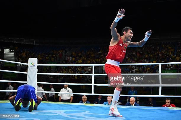 Germany's Artem Harutyunyan celebrates winning against Turkey's Batuhan Gozgec during the Men's Light Welter Quarterfinal 3 match at the Rio 2016...