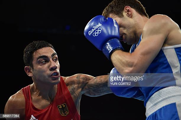 Germany's Artem Harutyunyan fights Canada's Arthur Biyarslanov during the Men's Light Welter match at the Rio 2016 Olympic Games at the Riocentro...
