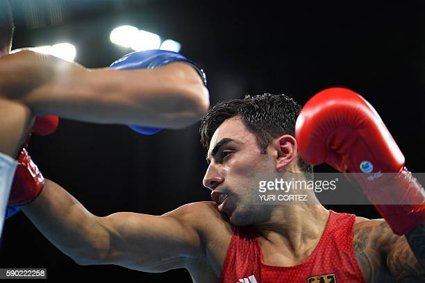 Germany's Artem Harutyunyan fights Turkey's Batuhan Gozgec during the Men's Light Welter Quarterfinal 3 match at the Rio 2016 Olympic Games at the...