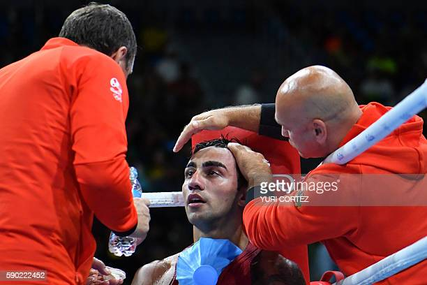 Germany's Artem Harutyunyan is attended to as he takes a break from fighting against Turkey's Batuhan Gozgec during the Men's Light Welter...