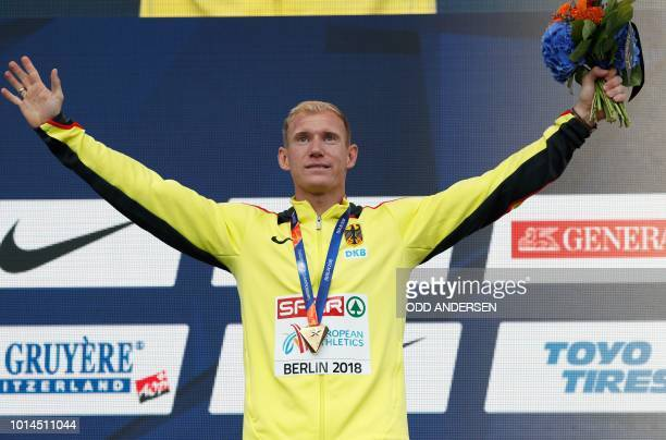 Germany's Arthur Abele celebrates on the podium during the medal ceremony for the Men's Decathlon during the European Athletics Championships in...