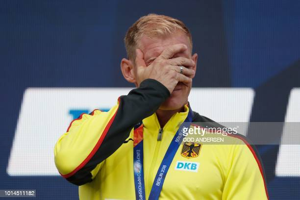 Germany's Arthur Abele reacts on the podium during the medal ceremony for the Men's Decathlon during the European Athletics Championships in Berlin...