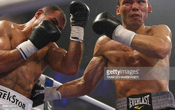 Germany's Arthur Abraham vies with Raul Marquez of the US to defeat him in a sixth-round technical knock-out win in their IBF middleweight boxing...