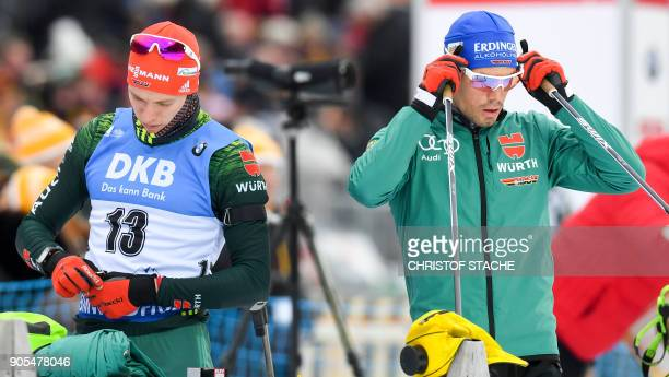 Germany's Benedikt Doll and arrives compatriot Simon Schempp get ready for the warmup shooting prior the men's 15 kilometer mass start competition at...