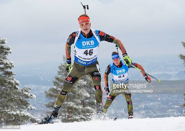 Germany's Benedikt Doll and Germanys Simon Schempp compete during the Men's 10 km Sprint event at the IBU World Championships Biathlon competition in...