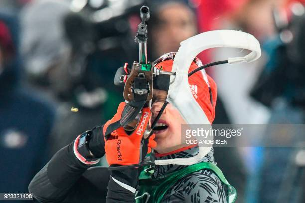 TOPSHOT Germany's Benedikt Doll competes at the shooting range in the men's 4x75km biathlon event during the Pyeongchang 2018 Winter Olympic Games on...