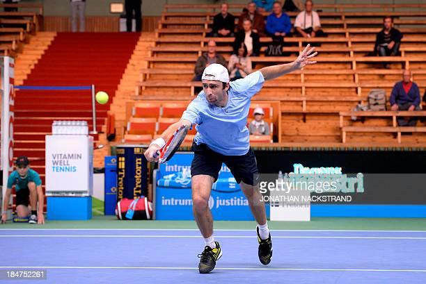 Germany's Benjamin Becker returns the ball to Finland's Jarkko Nieminen during the ATP Stockholm Open tennis tournament on October 16 2013 in...