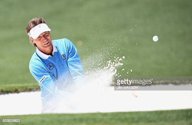 Germany's Bernhard Langer hits out of a bunker on the 2nd hole during Round 3 of the 80th Masters Golf Tournament at the Augusta National Golf Club...