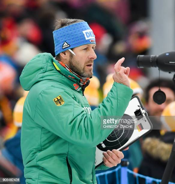 Germany's biathlon coach Mark Kirchner gestures during the warmup shooting prior the men's 15 kilometer mass start competition at the Biathlon World...
