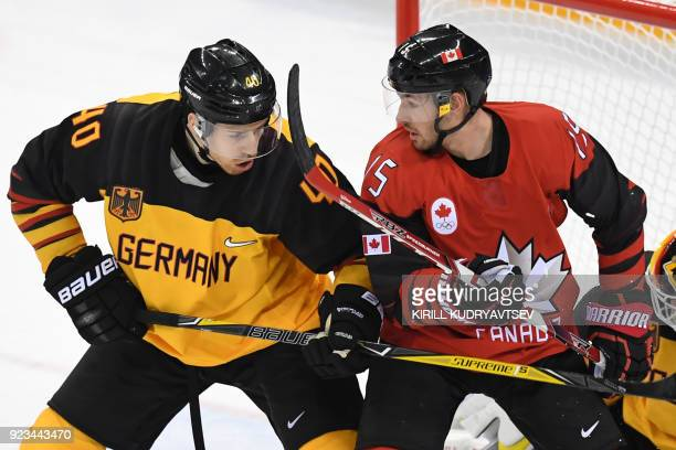TOPSHOT Germany's Bjorn Krupp and Canada's Brandon Kozun compete in the men's semifinal ice hockey match between Canada and Germany during the...