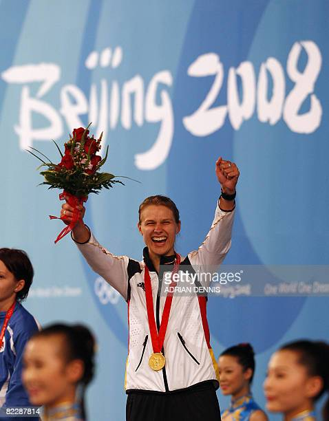 Germany's Britta Heidemann celebrates on the podium after winning the women's individual Epee tournament on August 13 2008 at the Fencing Hall of...