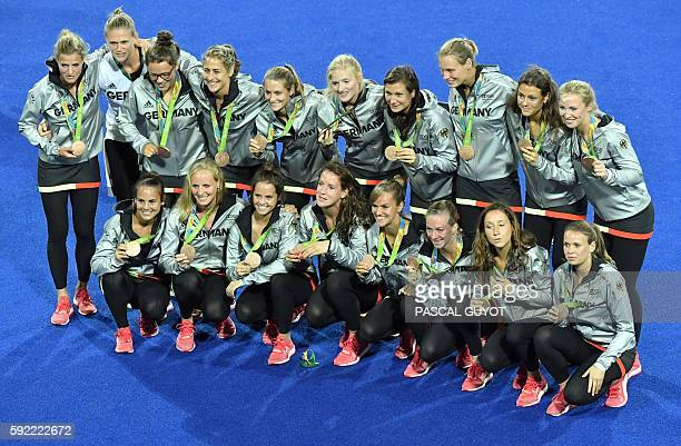 Germany's bronze medallists pose during the women's field hockey medals ceremony of the Rio 2016 Olympics Games at the Olympic Hockey Centre in Rio...