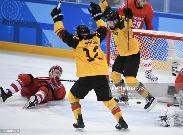 Germany's Brooks Macek and Germany's Patrick Hager celebrate a goal in the men's gold medal ice hockey match between the Olympic Athletes from Russia...