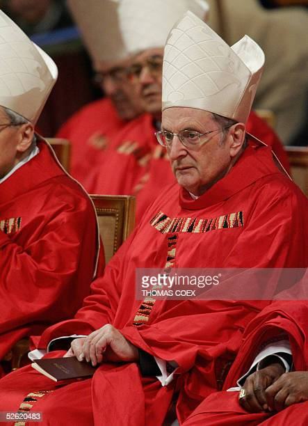 Germany's Cardinal Joachim Meisner attends a mass celebrated by Brazilian Cardinal Eugenio Sales de Araujo in St Peter's Basilica at the Vatican 12...