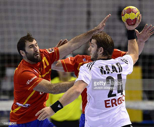 Germany's centre back Michael Haas vies with Spain's centre back Joan Canellas during the 23rd Men's Handball World Championships quarterfinal match...