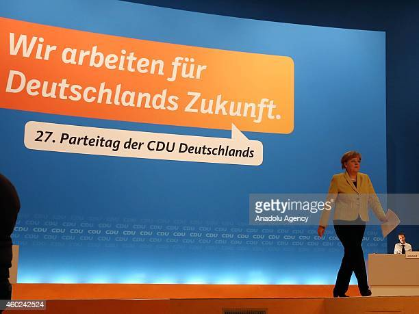 Germany's Chancellor and head of Christian Democratic Union Angela Merkel walks to give a speech at CDU's closure session of the 27th party congress...