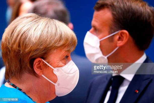 TOPSHOT Germany's Chancellor Angela Merkel and France's President Emmanuel Macron attends an EU summit at the European Council building in Brussels...