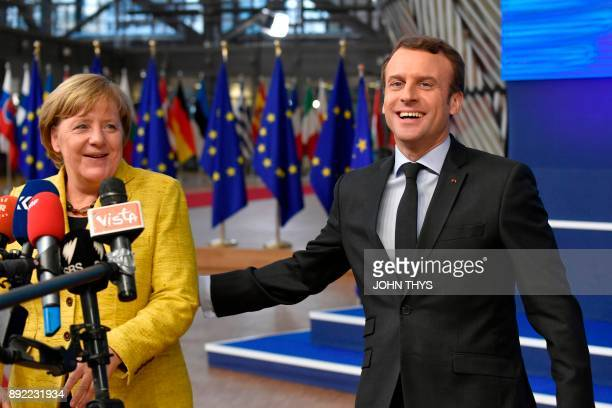Germany's Chancellor Angela Merkel and France's President Emmanuel Macron answer the press as they arrive to attend the first day of a European union...