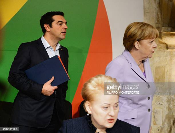Germany's Chancellor Angela Merkel and Greece's Prime minister Alexis Tsipras are pictured before the start of an Informal European Council meeting...