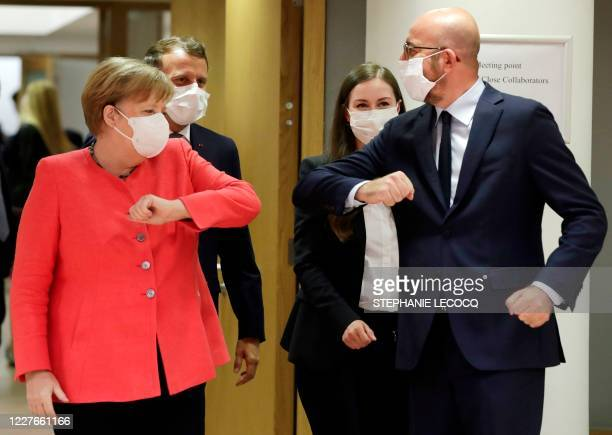 Germany's Chancellor Angela Merkel and President of the European Council Charles Michel greets prior the start of the European Union Council in...