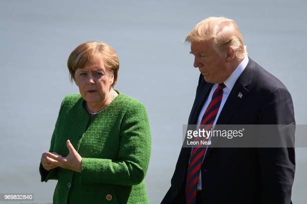 Germany's Chancellor Angela Merkel and President of the United States of America Donald Trump speak together following the Family photo on the first...