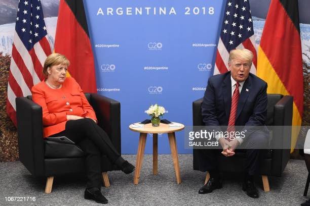 Germanys Chancellor Angela Merkel and US President Donald Trump hold a bilateral meeting, on the sidelines of the G20 Leaders' Summit in Buenos...