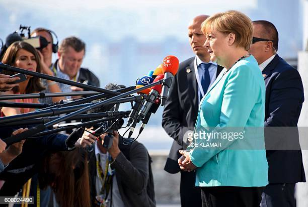 Germany's Chancellor Angela Merkel apeaks to media as she arrives for the informal EU summit at the Bratislava Castle in the Slovak capital on...