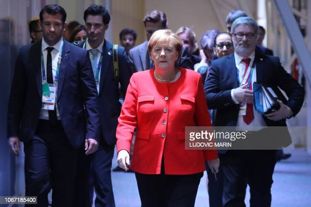 Germanys Chancellor Angela Merkel arrives for a bilateral meeting on the second day of the G20 Leaders' Summit in Buenos Aires on December 01 2018...