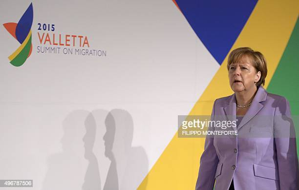 Germany's Chancellor Angela Merkel arrives for the second working session of the European Union - Africa Summit on Migration at the Meditterranean...