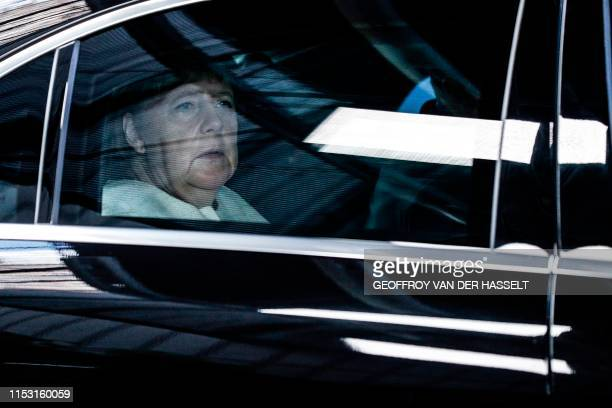 Germany's Chancellor Angela Merkel arrives for the third straight day of a European Union leaders summit in Brussels on July 2 for talks aimed at...