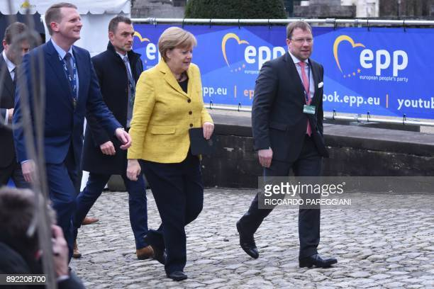 Germany's Chancellor Angela Merkel arrives to attend a meeting of the European People's Party in Brussels on December 14 ahead of a summit of...