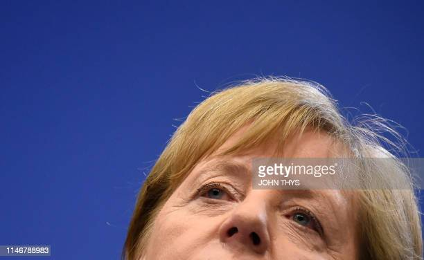 TOPSHOT Germany's Chancellor Angela Merkel gestures as she addresses media representatives after a European Union summit at EU Commission...