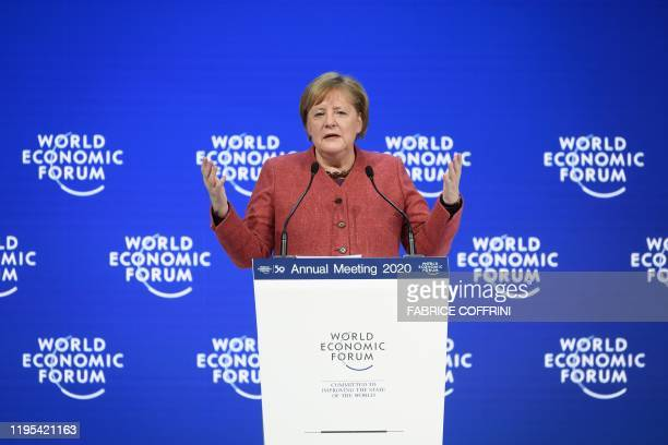 Germany's Chancellor Angela Merkel gestures as she delivers a speech at the World Economic Forum annual meeting in Davos on January 23 2020