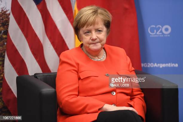 Germanys Chancellor Angela Merkel gestures during a bilateral meeting with US President Donald Trump, on the sidelines of the G20 Leaders' Summit in...