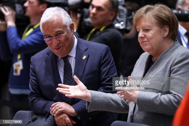 Germany's Chancellor Angela Merkel gestures next to Portugal's Prime Minister Antonio Costa prior to a plenary session during the second day of a...