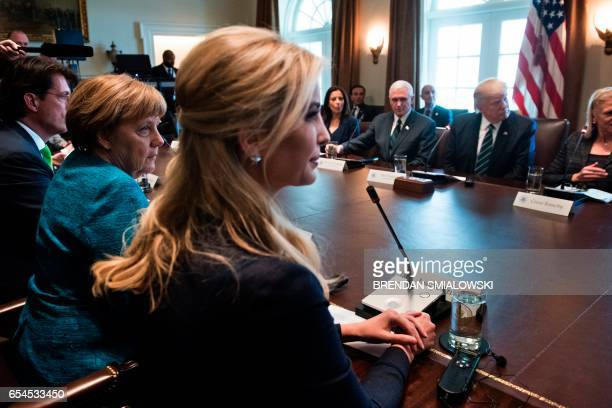 Germany's Chancellor Angela Merkel Ivanka Trump US Vice President Mike Pence US President Donald Trump and others wait for a meeting with business...