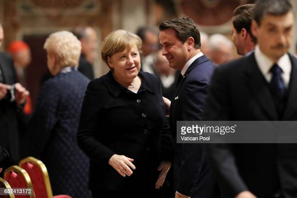 Germany's Chancellor Angela Merkel Luxembourg's Prime Minister Xavier Bettel and partner Gauthier Destenay attend a meeting with Pope Francis at the...