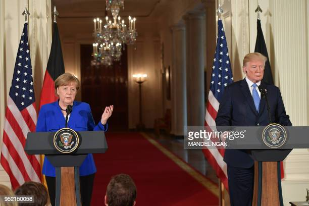 Germany's Chancellor Angela Merkel speaks during a joint press conference with US President Donald Trump in the East Room of the White House on April...